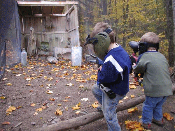 two young boys with paintball guns at mill run jellystone near pittsburgh