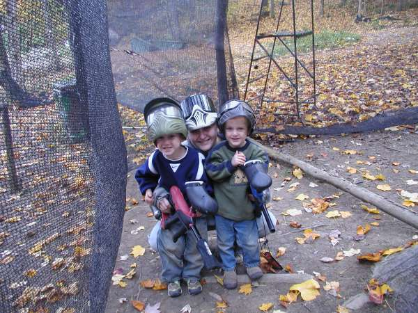 mom with two young boys at paintball at mill run jellystone near pittsburgh